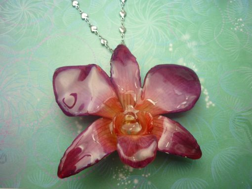 Real Orchid Flower Necklace - Purple/Pink. This is a REAL Orchid flower which has been preserved in resin making a unique necklae