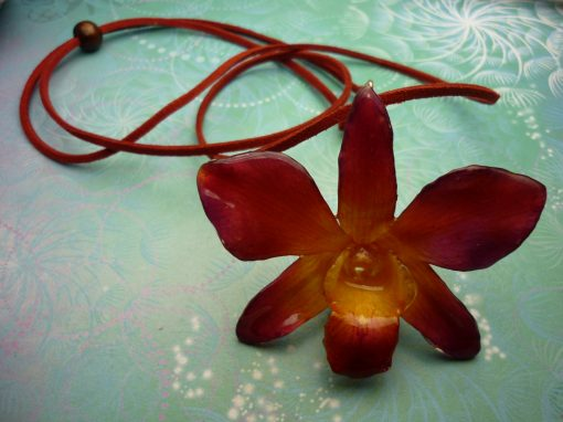 Real Orchid Flower Necklace - Purple/Red/Yellow. This is a REAL Orchid flower which has been preserved in resin making a unique necklace